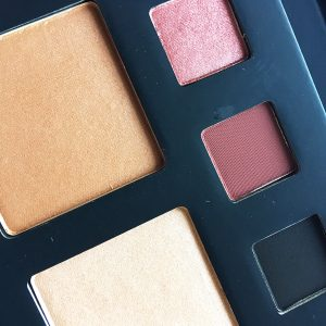 Close up of the Deck of Scarlet palette showing the three eye shadows, blush, and high lighter